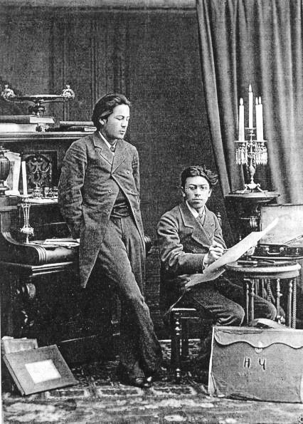 A. P. Chekhov (left) with Nikolai Chekhov (right), 1882; public domain image via Wikimedia Commons
